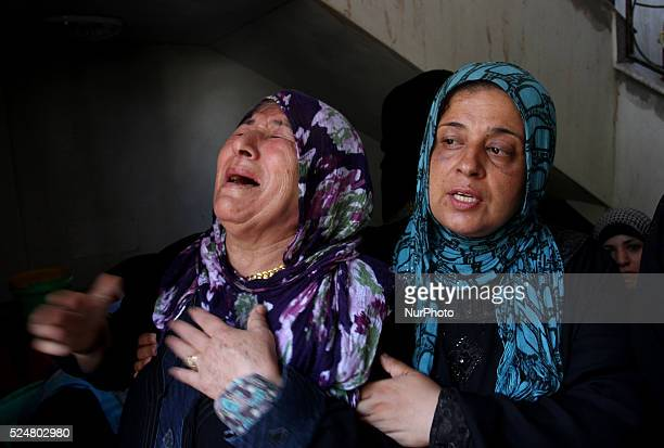 Palestinian relatives of the members of the Hamad family mourn during funeral in town of Beit Hanoun in the northern Gaza Strip on July 9 2014 five...