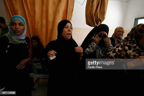 Palestinian relatives of three-year-old Palestinian child, Mouid al-Araj, mourns during his funeral in Khan Yunis, in the southern Gaza Strip....