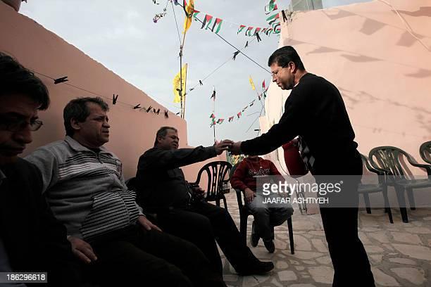 Palestinian released prisoner Muaed Hajji sits among relatives on October 30 2013 in the West Bank village of Burqa west of Nablus Israel freed 26...