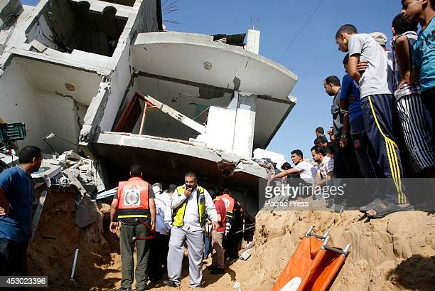 Palestinian rescue workers search the rubble for survivors following an Israeli military strike on Rafah in the southern Gaza Strip A Gaza ceasefire...