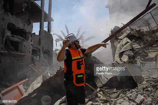 Palestinian rescuer tries to extinguish a fire that broke out in one of the houses east of Beit Hanoun after being targeted by the Israeli Air Force...
