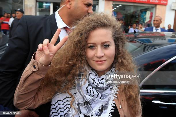 Palestinian resistance icon Ahed alTamimi who was awarded the 'Hanzala Award for Courage' in Turkey poses for a photo flashing victory sign during...