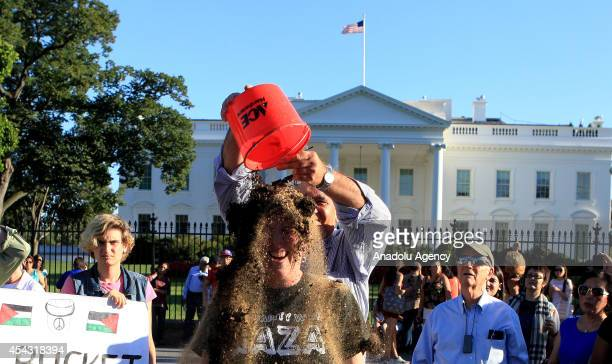 Palestinian rights activist gets a bucket of rubble on her head as she takes part in the Rubble Bucket challenge to show solidarity with Palestinians...