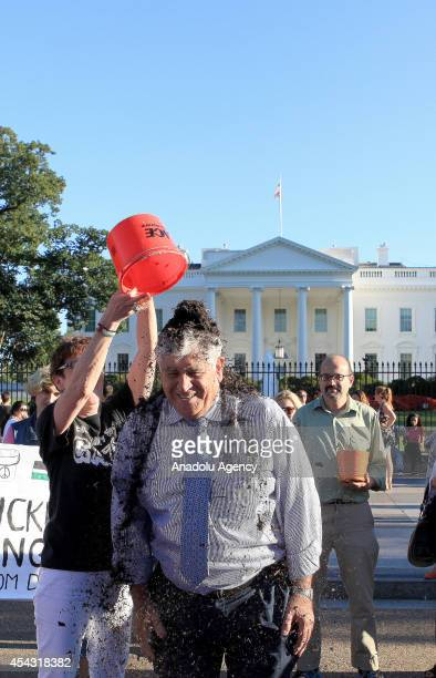 Palestinian rights activist gets a bucket of rubble on his head as he takes part in the Rubble Bucket challenge to show solidarity with Palestinians...