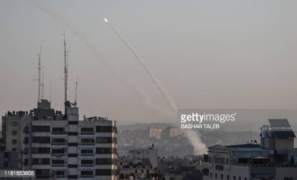 Palestinian rockets are being fired from Gaza city on November 12, 2019. - Israel's military killed a commander for Palestinian militant group...