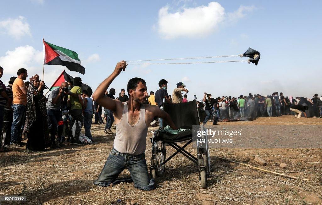 TOPSHOT-PALESTINIAN-ISRAEL-GAZA-CONFLICT : News Photo