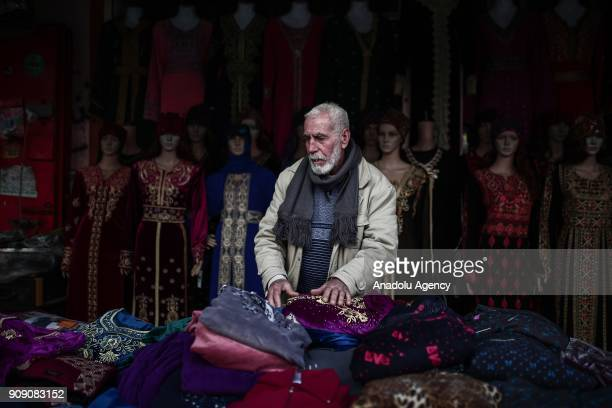Palestinian salesman stands in his shop in Gaza City Gaza on January 17 2018 Israel's blockage on Gaza which continues for 10 years has affected...