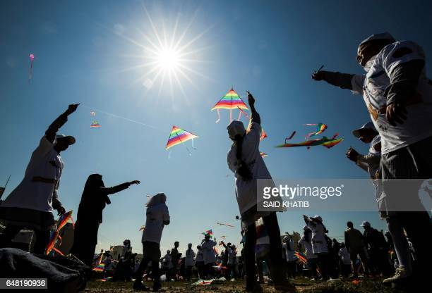 TOPSHOT Palestinian school children fly kites in a show of solidarity with the Japanese people during an event organised by the United Nations Relief...