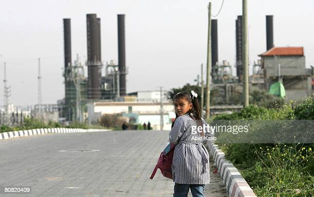 Palestinian school girl walks towards the main power plant April 22 2008 in AlNusairat Gaza Strip Israeli and Palestinian human right groups have...