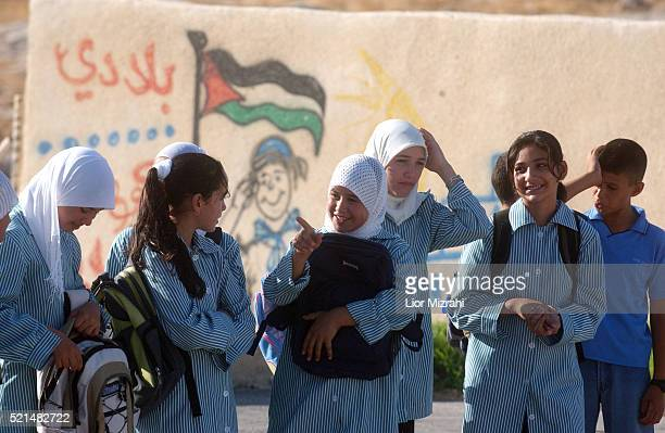 Palestinian schoolchildren at the West Bank village of AlKhas on the first day of the new academic year Saturday Sep 03 2005 Israeli peace activists...