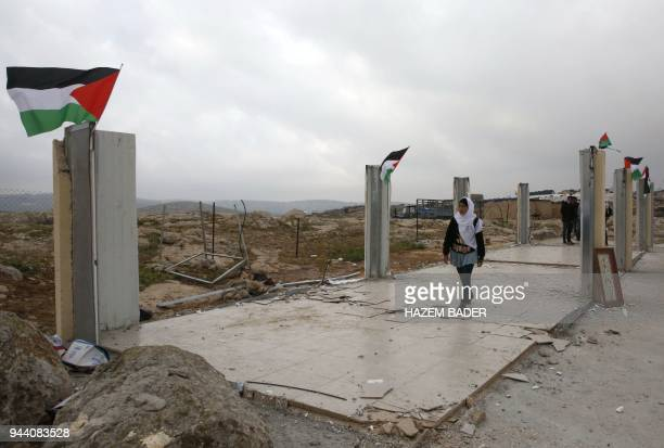 Palestinian schoolchildren check what's left of their school after it was demolished by Israeli forces who claim it was built on illegal land in the...