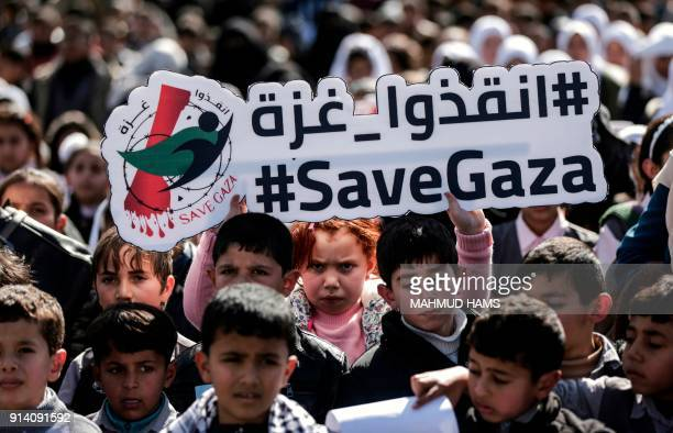 TOPSHOT Palestinian schoolchildren shout slogans and hold placards during a protest in Gaza city on February 4 against the difficult economic...