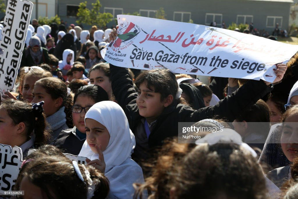 Palestinian schoolchildren shout slogans and hold placards during a protest in Gaza city on February 4, 2018, against the difficult economic situation and the US decision to withhold funds earmarked for the UN relief agency for Palestinian refugees, UNRWA.