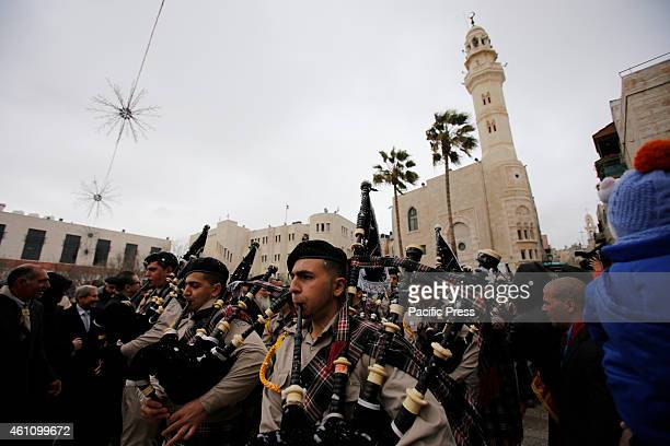 Palestinian Scouts perform in Manger Square in the West Bank town of Bethlehem January 6 just before the arrival of the Greek Orthodox Patriarch of...