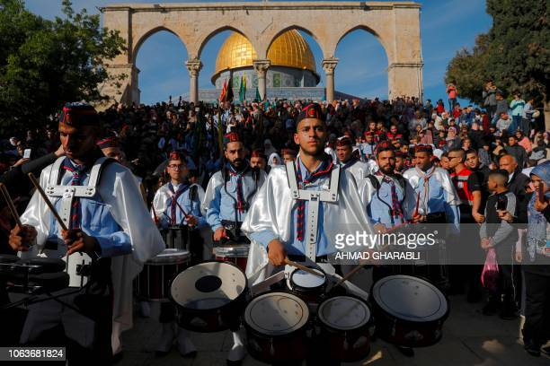Palestinian scouts play music during a ceremony commemorating the birth of Prophet Mohammed known in Arabic as 'alMawlid alNabawi' outside the Dome...