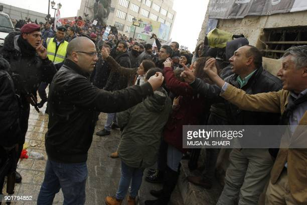 Palestinian security forces argue with protesters as after they attempted to block the convoy of Jerusalem's Greek Orthodox patriarch Theophilos III...