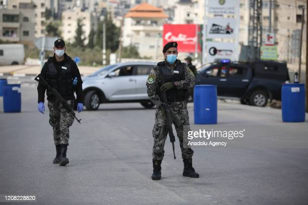 Palestinian security forces build checkpoints following the lockdown due to the coronavirus pandemic in Ramallah West Bank on March 25 2020