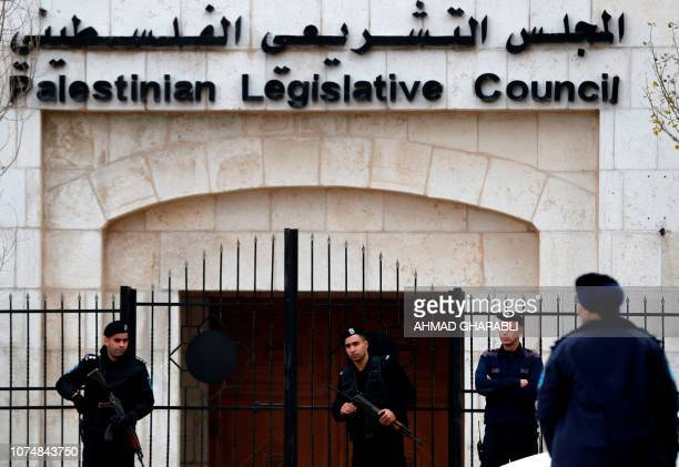 Palestinian security forces gather in front of the Palestinian Legislative Council building in Ramallah in the Israelioccupied West Bank on December...