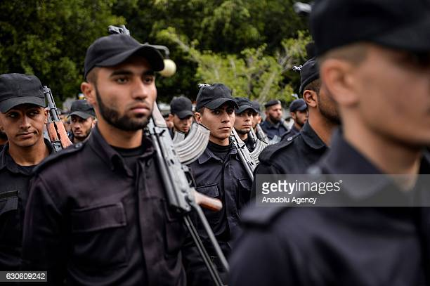 Palestinian security forces hold weapons during a military parade marking the 8th anniversary of Israeli attack on Gaza Strip called Operation Cast...