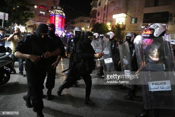 Palestinian security forces intervene in a demonstration in support of Gaza at AlManara Square in Ramallah West Bank on June 14 2018 Demonstrators...