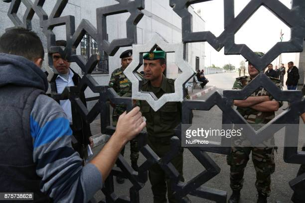 Palestinian security forces loyal to Hamas stand guard outside the Rafah border crossing with Egypt under the control of the Palestinian Authority as...