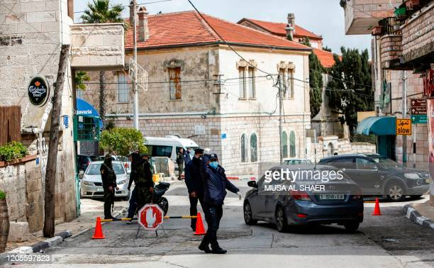 Palestinian security forces man a checkpoint in Beit Jala on the outskirts of the biblical city of Bethlehem in the occupied West Bank on March 7...