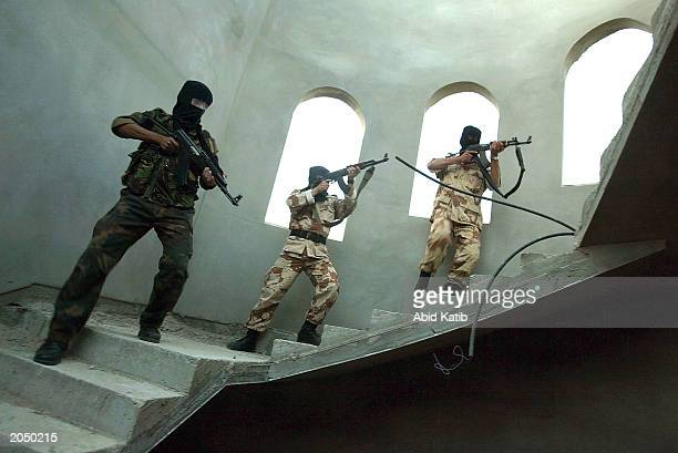 Palestinian security forces practice arrest operations June 2, 2003 at Rafah refugee camp in the Gaza Strip. Palestinian security forces stepped up...