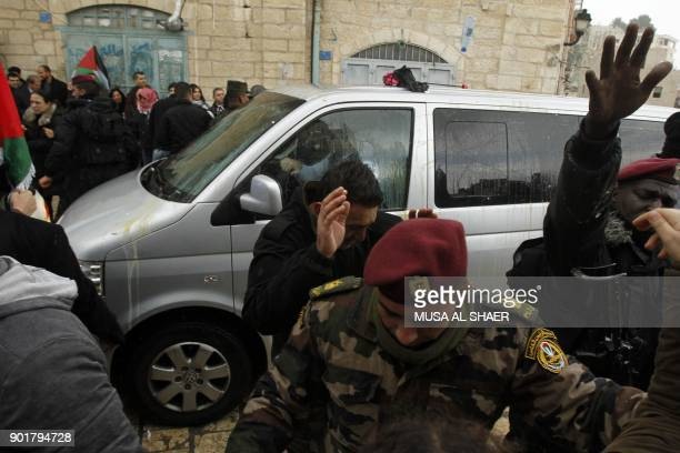 Palestinian security forces push away protesters from the convoy of Jerusalem's Greek Orthodox patriarch Theophilos III in the West Bank town of...