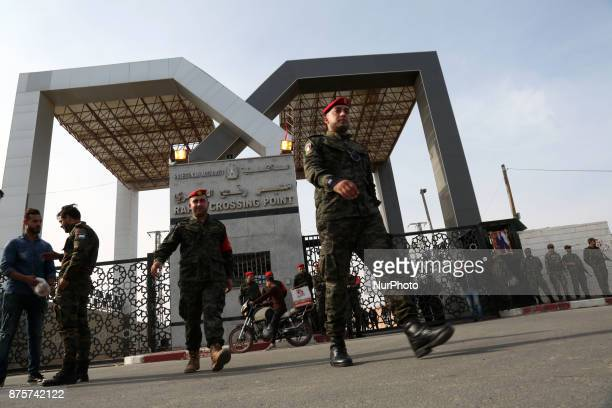 Palestinian security forces stand guard outside the Rafah border crossing with Egypt under the control of the Palestinian Authority in the southern...
