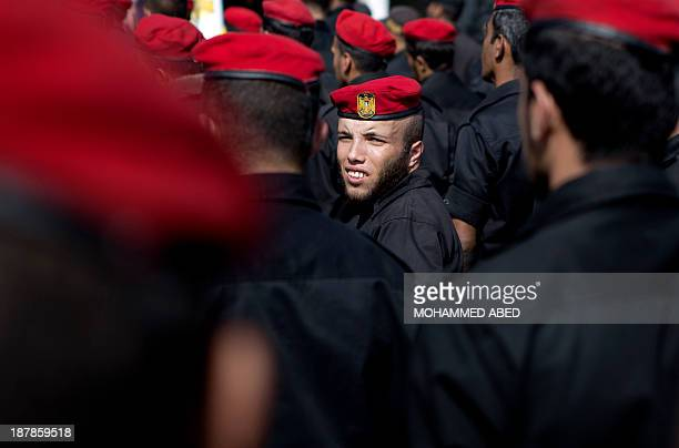 Palestinian security forces take part in an anti-Israel narch on November 13, 2013 in the streets of Gaza City as part of the celebrations marking...