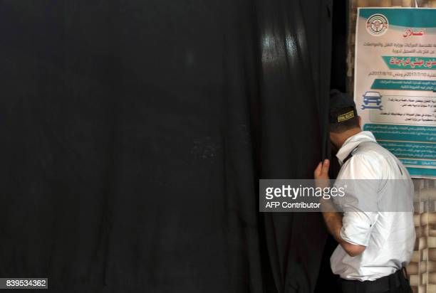 A Palestinian security guard watches the screening of '10 Years' at Samer Cinema in Gaza City on August 26 2017 The Samer Cinema in Gaza City the...