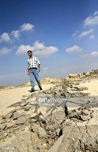 Palestinian security man walks on the Gaza International Airport strip that was destroyed by the Israeli army bulldozers two years ago in Rafah in...