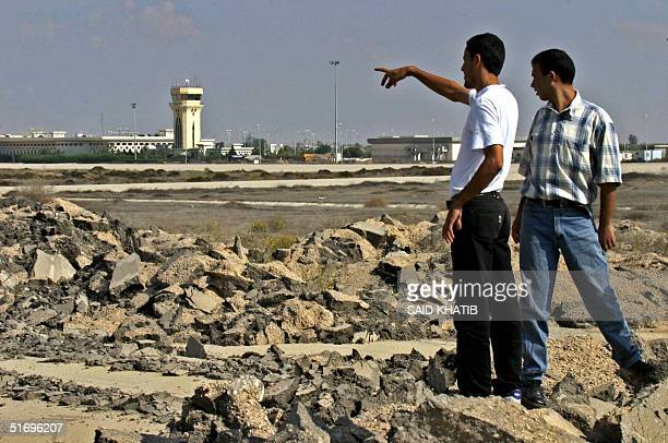Palestinian security men walk on the Gaza International Airport strip that was destroyed by the Israeli army bulldozers two years ago in Rafah in the...