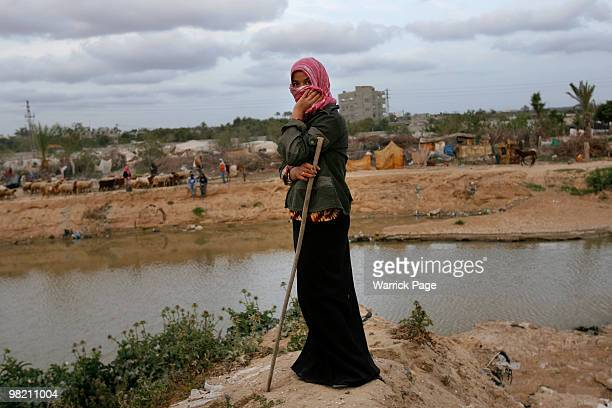 Palestinian shepherd watches over her flock next to a sewagecontaminated riverbed on March 25 2010 in Wadi Gaza Gaza Strip Once the primary water...