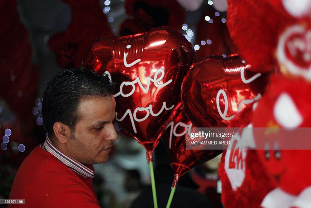 A Palestinian shopkeeper sells balloons on Valentine's Day in Gaza City on February 14, 2013. Valentine's Day is increasingly popular in the region as people have taken up the custom of giving flowers, cards, chocolates and gifts to sweethearts to celebrate the occasion.