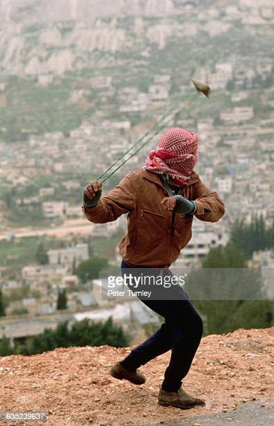 Palestinian Slinging a Rock
