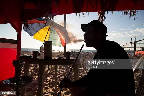 Palestinian smokes Shisha at Gaza beach Shisha a popular habit among youth Gazans shisha a water pipe used for smoking purposes originating about 500...