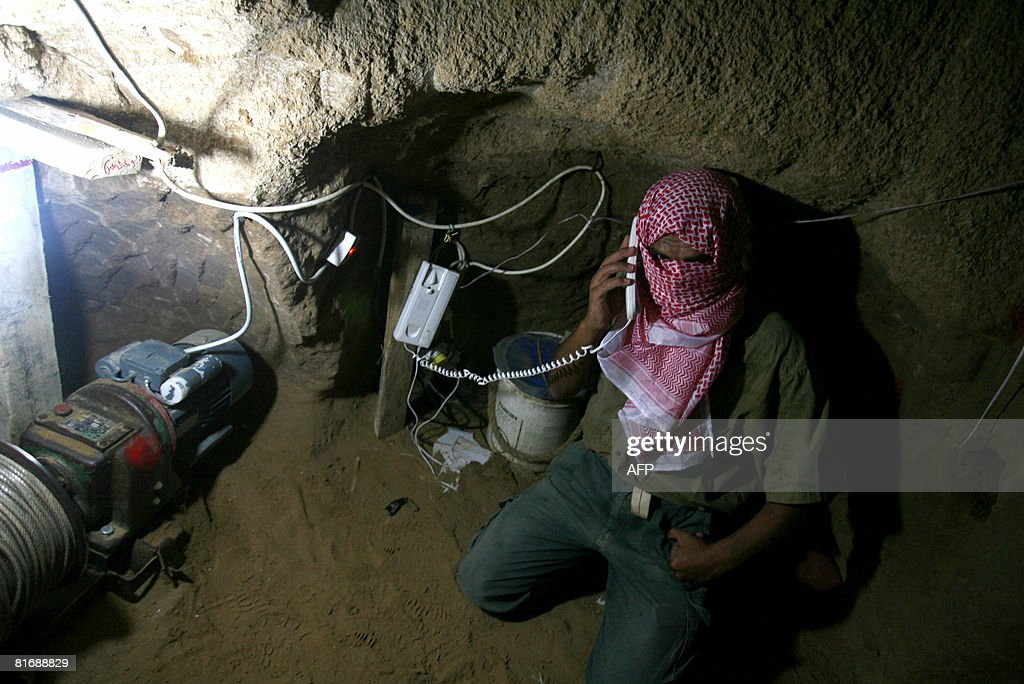 A Palestinian Smuggler Speaks On Telephone Wired To Connection The Egpytian Side Of