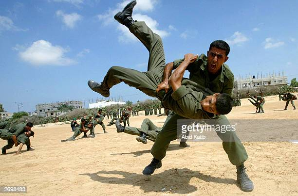 Palestinian soldiers with the national security troops demonstrate martial arts during commencement ceremonies for 166 new soldiers July 22, 2003 at...