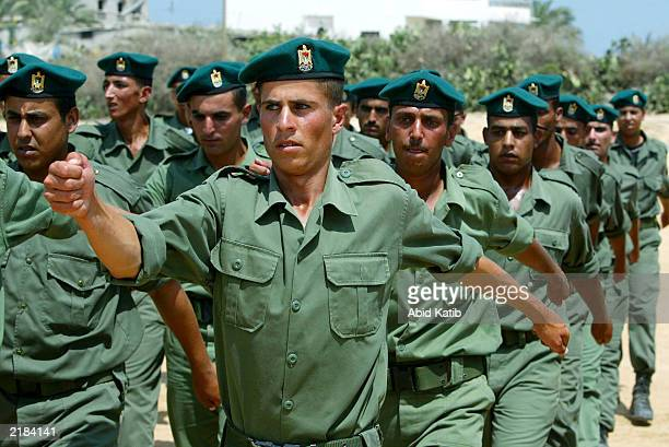 Palestinian soldiers with the national security troops march in a military show during commencement ceremonies for 166 new soldiers July 22 2003 at...