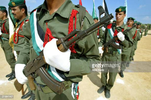 Palestinian soldiers with the national security troops participate in a military show during commencement ceremonies for 166 new soldiers July 22...