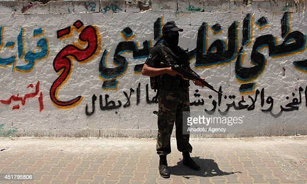 Palestinian stands guard during funeral for Marwan Sleem in the central Gaza Strip July 7 2014 Israeli airstrikes aiming Gaza leave 9 death from...
