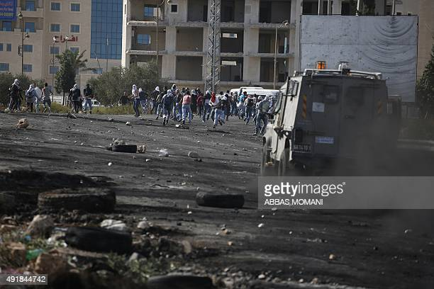 Palestinian stone throwers clash with Israeli security forces in Beit El Jewish settlement north of Ramallah in the occupied West Bank on October 8...