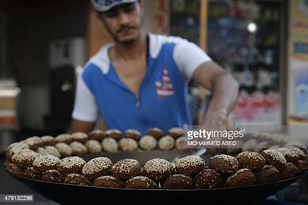 A Palestinian street vendor prepares falafel balls at an old market in Gaza City on the 14th day of the holy fasting month of Ramadan on July 1 2015...