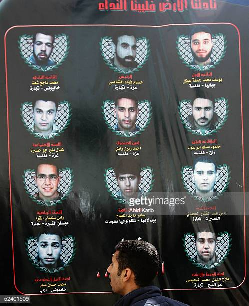 Palestinian student looks at the Mahmoud Abbas supporting Shuhada Falasten List during student council election at the Islamic University on March 14...
