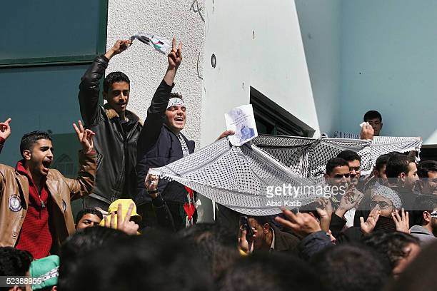 Palestinian student supporters of the Palestinian President Mahmoud Abbas shout slogans during student council election at the Islamic University on...
