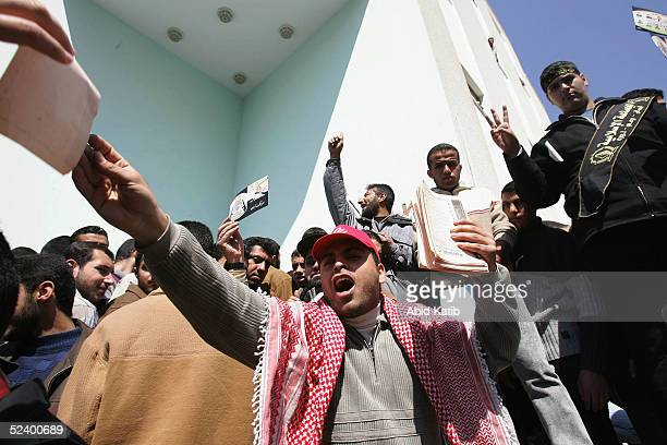 Palestinian student supporters of the Popular Front for the Liberation of Palestine shout slogan during student council election at the Islamic...