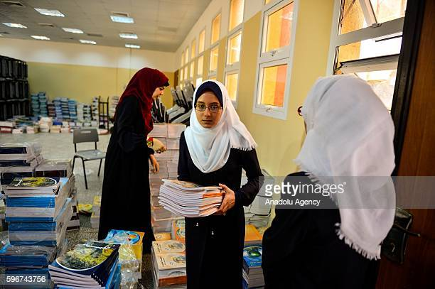 Palestinian student takes her books at Mahfouz El Nahnah high school on the first day of the new school year in Gaza City Gaza on August 28 2016
