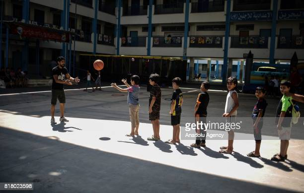 Palestinian students attend activities during a summer camp organized by the United Nations Relief and Works Agency for Palestine Refugees at Zaitoun...