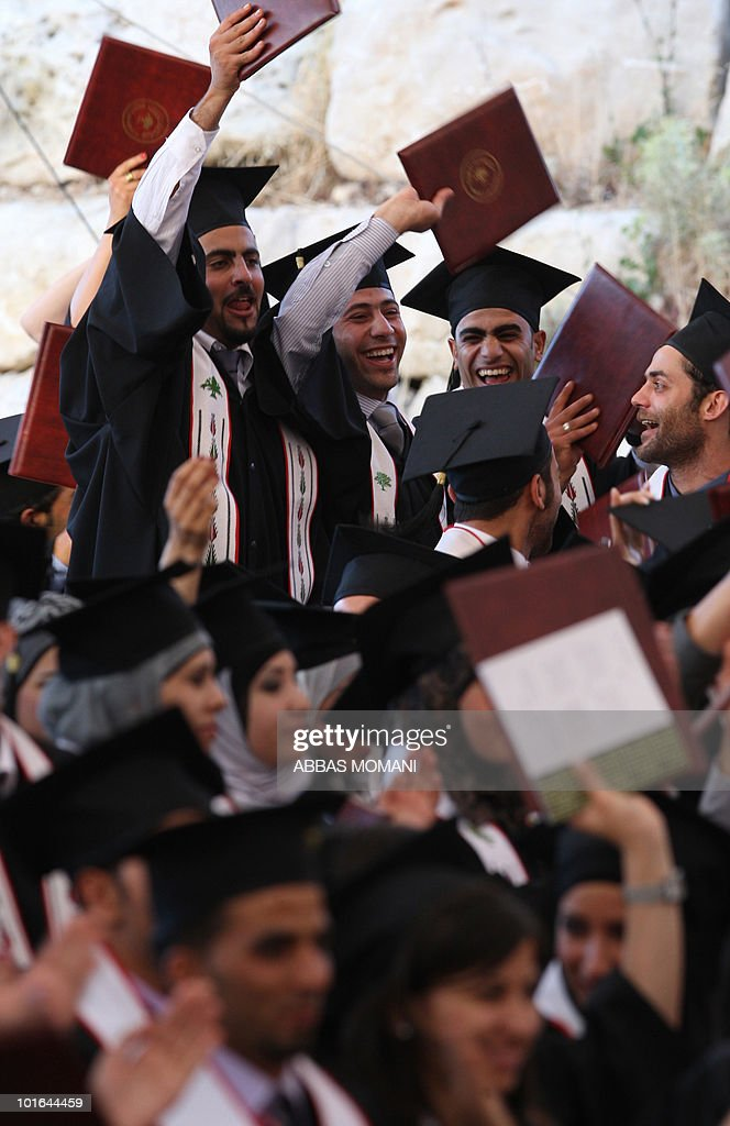 Palestinian students celebrate during their graduation ceremony at Birzeit University near the West Bank city of Ramallah on June 5, 2010, as some 8,500 students received their degrees at the end of the 2009-2010 school year.